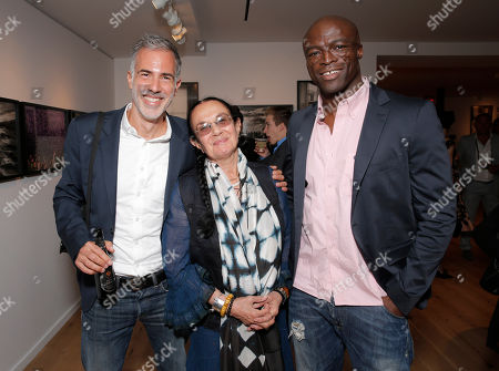 Photographers Yariv Milchan, Mary Ellen Mark and Seal attend the Leica Los Angeles Grand Opening, on in West Hollywood, California