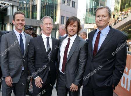 """Director Peter Berg, Jon Feltheimer, Chief Executive Officer of Lionsgate, Mark Wahlberg and Michael Burns, Vice President of Lionsgate, seen at Lionsgate's """"Deepwater Horizon"""" premiere at the 2016 Toronto International Festival, in Toronto"""