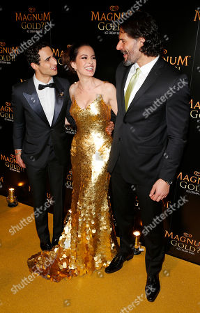 Couture designer Zac Posen, left, actress Caroline Correa AND actor Joe Manganiello arrive on the gold carpet of the As Good As Gold premiere, a new short film starring Joe Manganiello that celebrates the U.S. arrival of MAGNUM Gold?! Ice Cream. The film debuted during the Tribeca Film Festival in New York. Visit MagnumIceCream.com for more information