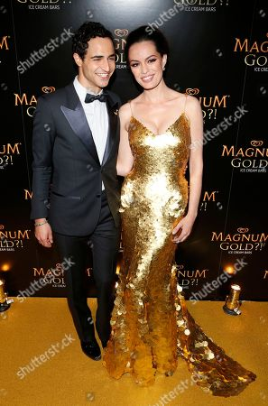Couture designer Zac Posen, left, and actress Caroline Correa arrive on the gold carpet of the â?˜As Good As Gold' premiere, a new short film starring Joe Manganiello that celebrates the U.S. arrival of MAGNUM Gold?! Ice Cream. The film debuted during the Tribeca Film Festival in New York. Visit MagnumIceCream.com for more information