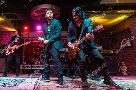 """From left, Sean McNabb, Franky Perez, and Gilby Clarke perform during the """"Music On A Mission"""" benefit concert held at Lucky Strike Live - Hollywood on in Los Angeles"""