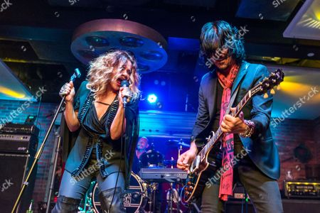 """Nikka Costa, left, and Gilby Clarke perform during the """"Music On A Mission"""" benefit concert held at Lucky Strike Live - Hollywood on in Los Angeles"""