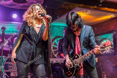 "Nikka Costa, left, and Gilby Clarke perform during the ""Music On A Mission"" benefit concert held at Lucky Strike Live - Hollywood on in Los Angeles"