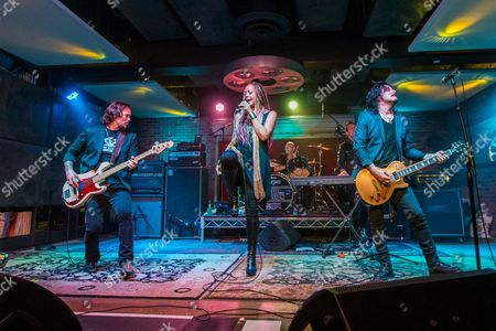 "From left, Sean McNabb, Debby Holiday, Matt Starr, Steve Ferlazzo and Gilby Clarke perform during the ""Music On A Mission"" benefit concert held at Lucky Strike Live - Hollywood on in Los Angeles"