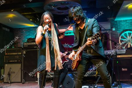 "Debby Holiday, left, and Gilby Clarke perform during the ""Music On A Mission"" benefit concert held at Lucky Strike Live - Hollywood on in Los Angeles"