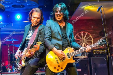 """Sean McNabb, left, and Gilby Clarke perform during the """"Music On A Mission"""" benefit concert held at Lucky Strike Live - Hollywood on in Los Angeles"""