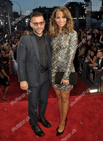Anthony Mandler, left, and Denise Vasi arrive at the MTV Video Music Awards at Barclays Center, in the Brooklyn borough of New York