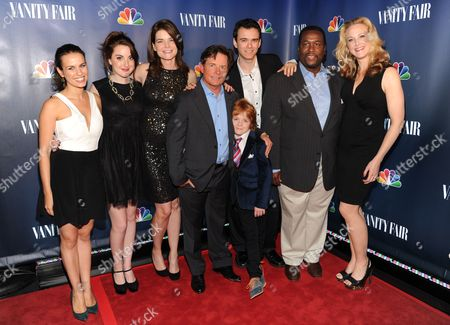 """The Michael J. Fox"""" cast, from left, Ana Nogueira, Juliette Goglia, Betsy Brandt, Michael J. Fox, Jack Gore, Conor Romero, Wendell Pierce and Katie Finneran attend the NBC 2013 Fall season launch party hosted by Vanity Fair at Le Bain on in New York"""