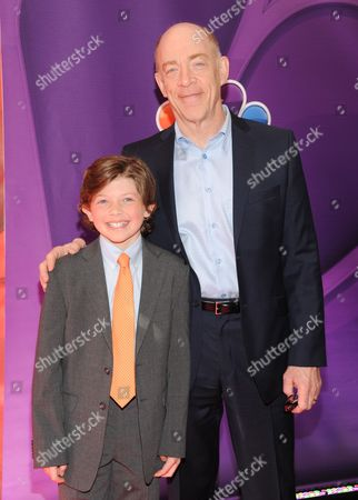 Actors Eli Baker, left, and JK Simmons attend the NBC Network 2013 Upfront at Radio City Music Hall on in New York