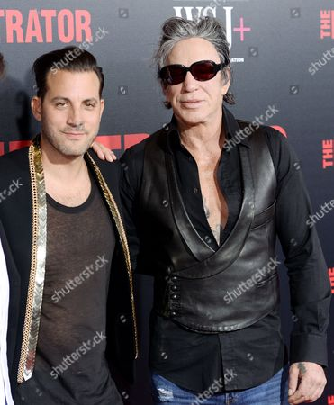 """Director Brad Furman, left, and actor Mickey Rourke attend the premiere of """"The Infiltrator"""" at AMC Loews Lincoln Square, in New York"""