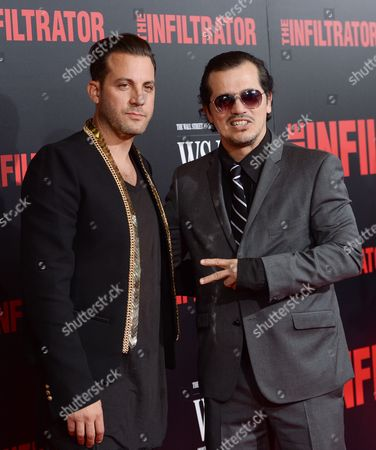 """Director Brad Furman, left, and actor John Leguizamo attend the premiere of """"The Infiltrator"""" at AMC Loews Lincoln Square, in New York"""