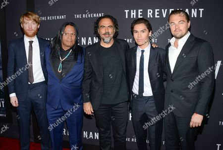 "Director Alejandro G. Inarritu, center, poses with actors, from left, Domhnall Gleeson, Arthur Redcloud, Forrest Goodluck and Leonardo DiCaprio at the premiere for ""The Revenant"" at AMC Loews Lincoln Square, in New York"