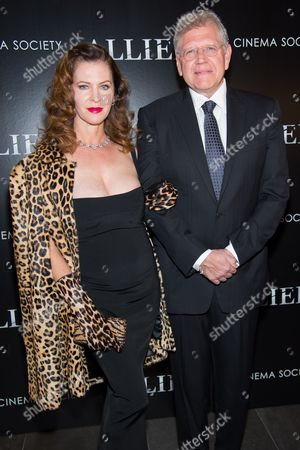 """Director Robert Zemeckis, right, and Leslie Harter Zemeckis attend a special screening of """"Allied"""", hosted by The Cinema Society, at iPic Theater, in New York"""