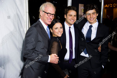 """Julia Louis-Dreyfus, second left, husband Brad Hall, left, sons Charles Hall, right, and Henry Hall attend a special screening of """"Enough Said"""", in New York"""