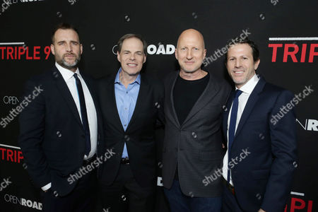 Stock Picture of Producer Keith Redmon, Tom Ortenberg, Chief Executive Officer of Open Road Films, Director John Hillcoat and Producer Bard Dorros seen at Open Road's 'Triple 9' Los Angeles Premiere at Regal L.A. Live, in Los Angeles, CA