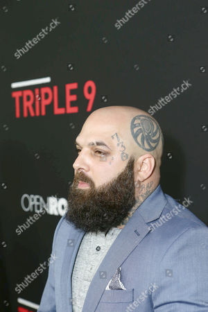 Carlos Aviles seen at Open Road's 'Triple 9' Los Angeles Premiere at Regal L.A. Live, in Los Angeles, CA
