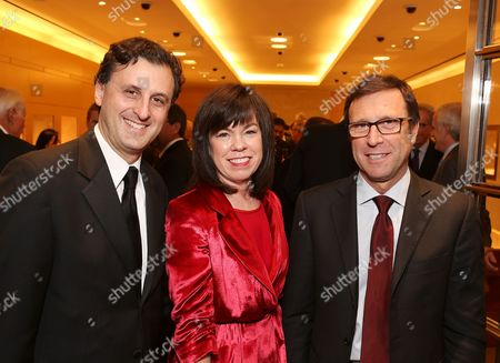 Stock Photo of From left, John E. Forsyte, President Pacific Symphony; Debra Gunn Downing, Executive Director of Marketing for South Coast Plaza and Alberto Festa, North American President Bulgari pose during a benefit for the Pacific Symphony held at the Bulgari Boutique in South Coast Plaza on in Costa Mesa, Calif