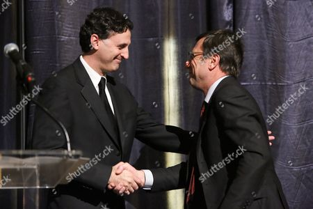 Stock Picture of From left, John E. Forsyte, President Pacific Symphony shakes hands with Alberto Festa, North American President Bulgari during a Bulgari benefit dinner for the Pacific Symphony at South Coast Plaza on in Costa Mesa, Calif