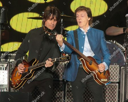 Rusty Anderson, left, and Paul McCartney perform in concert at Hersheypark Stadium, in Hershey, Pa