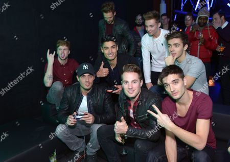 The Wanted Max George, Nathan Sykes, Jay McGuiness, Tom Parker, Siva Kaneswaran, Lawson Andy Brown and Adam Pitts, and Ollie Marland play the new PlayStation4 during an exclusive preview at the OXO Tower to celebrate the of the console in the UK,, in London