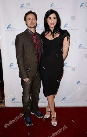 Actress and comedian Sarah Silverman, right, and comedian Kyle Dunnigan arrive at the Saban Community Clinic's benefit gala at the Beverly Hilton on in Beverly Hills, Calif