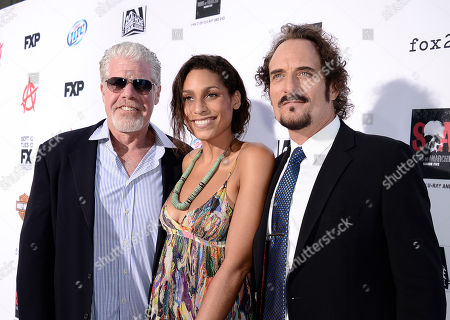 From left to right, Actor Ron Perlman, daughter, Blake Perlman and actor Kim Coates arrive on the red carpet at the season six premiere screening of the television series 'Sons of Anarchy' at the Dolby Theatre on in Los Angeles