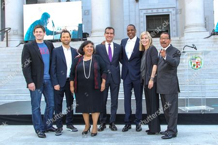 From left, Brian Perkins, Vice President of Budweiser, Michael Rapino, President and CEO of Live Nation Entertainment, Gloria Molina, County Supervisor, Mayor Eric Garcetti, Shawn 'Jay-Z' Carter, Elise Buik, President and CEO of United Way, and Herb Wesson, Council President announce the Made in America Festival from the steps of City Hall on in Los Angeles
