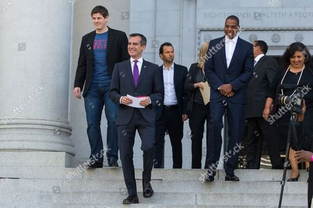 From left, Brian Perkins, Vice President of Budweiser, Mayor Eric Garcetti, Michael Rapino, President and CEO of Live Nation Entertainment, Elise Buik, President and CEO of United Way, Shawn 'Jay-Z' Carter, Herb Wesson, Council President, and Gloria Molina, County Supervisor, announce the Made in America Festival from the steps of City Hall on in Los Angeles