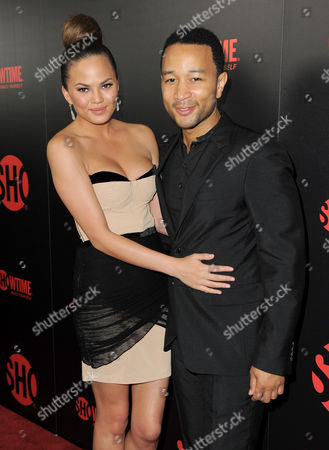 John Legend, right, and Chrissy Tiegan attend the Showtime Emmy Eve Soiree at the Sunset Tower Hotel, in Los Angeles