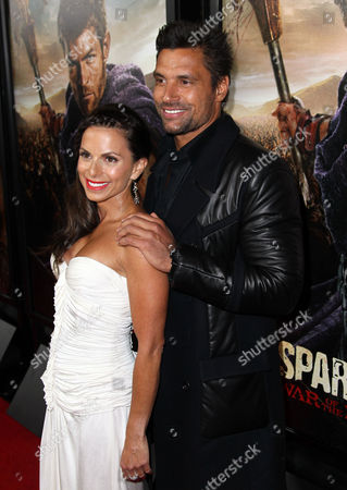 """Manu Bennett, right, and Karin Horen arrive at the premiere of """"Spartacus: War of the Damned"""" on in Los Angeles. """"Spartacus: War of the Damned"""" premieres Friday, Jan. 25 at 9PM on STARZ"""