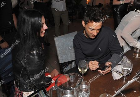Stock Picture of George Kotsiopoulos, right, and Magda Berliner attend SpinMedia Supper Club hosted by Johnny Wujek, in Los Angeles