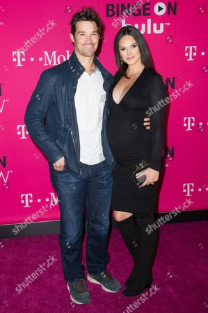 C. J. Wilson and Lisalla Montenegro attends T-Mobile's Launch of Un-carrier X held at the Shrine Auditorium, in Los Angeles