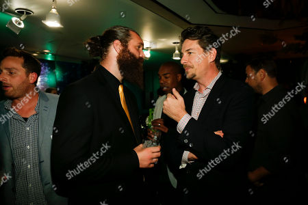 Harley Morenstein, left, and Chris Jacobs talk at the Television Academy's 66th Emmy Interactive Media Nominee Reception at the Television Academy on in the NoHo Arts District in Los Angeles