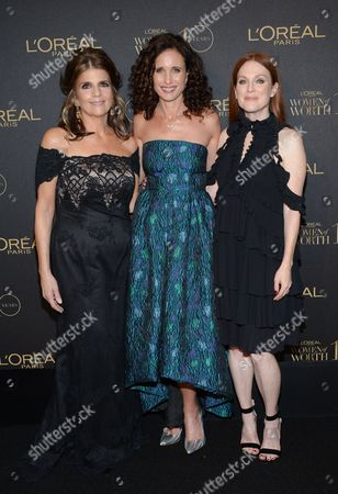"""President of L'Oreal Paris Karen Fondu, left, actress Andie MacDowell and actress Julianne Moore attend the tenth annual L'Oreal Paris """"Women of Worth"""" awards gala at The Pierre Hotel, in New York"""