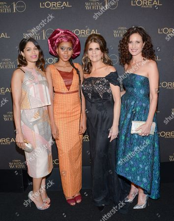 """Actress Freida Pinto, left, honoree and Safe Hands For Girls founder Jaha Dukureh, President of L'Oreal Paris Karen Fondu and actress Andie MacDowell pose together at the tenth annual L'Oreal Paris """"Women of Worth"""" awards gala at The Pierre Hotel, in New York"""