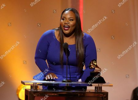 """Tasha Cobbs accepts the award for best gospel/contemporary christian music performance for """"Break Every Chain [LIVE}"""" at the pre-telecast of the 56th annual GRAMMY Awards, in Los Angeles"""