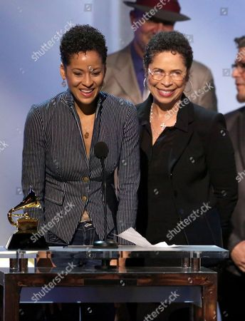 "Kori Withers, left, and Marcia Withers accept the award for best historical album on behalf of Bill Withers for ""The Complete Sussex And Columbia Albums"" at the pre-telecast of the 56th annual GRAMMY Awards, in Los Angeles"