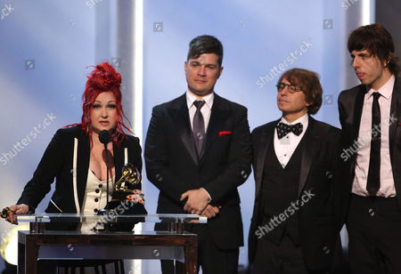 """From left, Cyndi Lauper, Stephen Oremus, William Wittman and Sammy James Jr. accept the best musical theater album award for """"Kinky Boots"""" at the pre-telecast of the 56th annual GRAMMY Awards, in Los Angeles"""