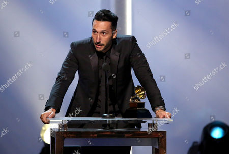 """Cedric Gervais accepts the best remixed recordings, non-classical award for """"Summertime Sadness"""" at the pre-telecast of the 56th annual GRAMMY Awards, in Los Angeles"""