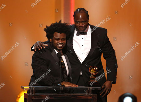 """Jerome Harmon, right, and James Fauntleroy II accept the award for best R&B song for """"Pusher Love Girl"""" at the pre-telecast of the 56th annual GRAMMY Awards, in Los Angeles"""
