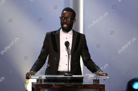 Presenter Tye Tribbett speaks on stage at the pre-telecast of the 56th annual GRAMMY Awards, in Los Angeles