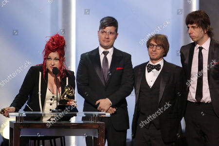 """Cyndi Lauper, from left, Stephen Oremus, William Wittman and Sammy James Jr. accept the best musical theater album award for """"Kinky Boots"""" at the pre-telecast of the 56th annual GRAMMY Awards, in Los Angeles"""