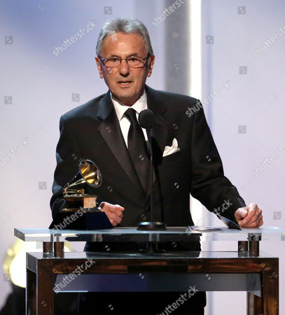 """Al Schmitt accepts the best surround sound album award for """"Live Kisses"""" at the pre-telecast of the 56th annual GRAMMY Awards, in Los Angeles"""