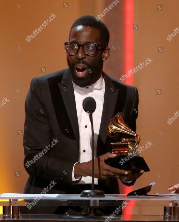 """Tye Tribbett reacts on stage as he is announced the winner for the best gospel song award for """"If He Did It Before... Same God [Live]"""" at the pre-telecast of the 56th annual GRAMMY Awards, in Los Angeles"""