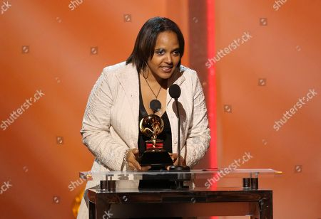 """Terri Lyne Carrington accepts the award for best jazz instrumental album for """"Money Jungle: Provocative In Blue"""" at the pre-telecast of the 56th annual GRAMMY Awards, in Los Angeles"""
