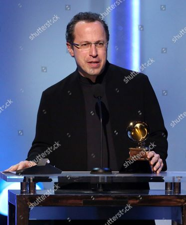 """Stock Photo of David Alan Miller accepts the award for best classical instrumental solo for """"Corigliano: Conjurer - Concerto For Percussionist & String Orchestra"""" at the pre-telecast of the 56th annual GRAMMY Awards, in Los Angeles"""