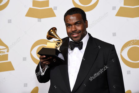 """Rodney Jerkins poses in the press room with the award for record of the year for """"Stay With Me"""" at the 57th annual Grammy Awards at the Staples Center, in Los Angeles"""