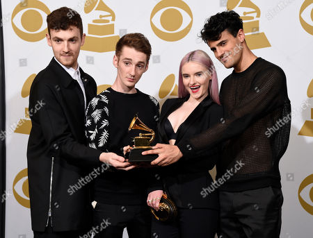 Jack Patterson, from left, Luke Patterson, Grace Chatto and Milan Neil Amin-Smith, of Clean Bandit, pose in the press room with the award for best dance recording for Rather Be at the 57th annual Grammy Awards at the Staples Center, in Los Angeles