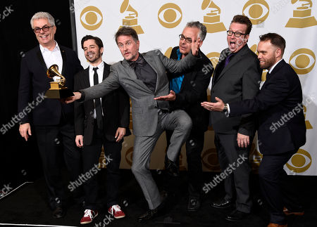 Gregg Field, from left, Andrew Synowiec, Gordon Goodwin, Sal Lozano, Bernie Dresel and Kevin Garren, of Gordon Goodwin's Big Phat Band, pose in the press room with the award for best large jazz ensemble album for Life in the Bubble at the 57th annual Grammy Awards at the Staples Center, in Los Angeles