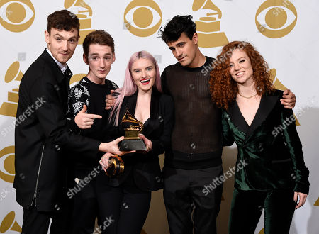 Jack Patterson, from left, Luke Patterson, Grace Chatto and Milan Neil Amin-Smith, of Clean Bandit, and Jess Glynne pose in the press room with the award for best dance recording for Rather Be at the 57th annual Grammy Awards at the Staples Center, in Los Angeles